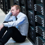 data center recycling, laptop recycling, server recycling, image showing a worried man sitting on the floor